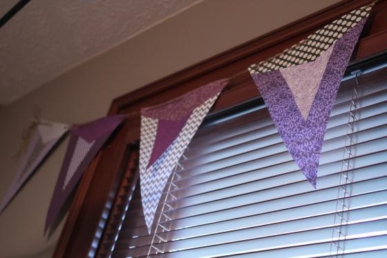 Flag banner... cheaper than curtains.
